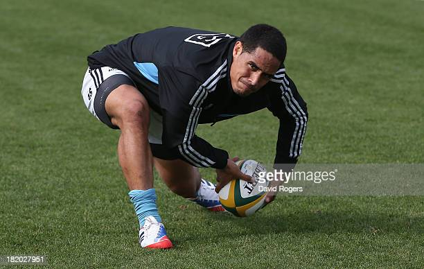 Aaron Smith passes the ball during the New Zealand All Blacks captain's run at the San Isidro Club on September 27 2013 in Buenos Aires Argentina