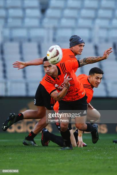 Aaron Smith passes the ball out during a New Zealand All Blacks training session at Eden Park on June 15 2017 in Auckland New Zealand