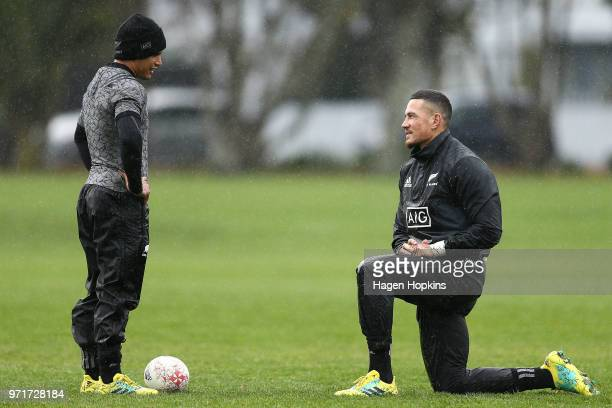 Aaron Smith talks to Sonny Bill Williams during a New Zealand All Blacks training session at Hutt Recreation Ground on June 12 2018 in Wellington New...