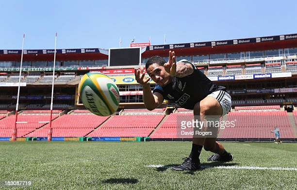 Aaron Smith the All Black scrumhalf passes the ball during the New Zealand All Blacks captain's run at Ellis Park on October 4 2013 in Johannesburg...