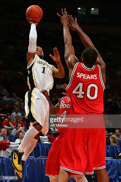 Aaron Spears of the St. Johns Red Storm defends against Dominic James of the Marquette Golden Eagles during the first round of the Big East...