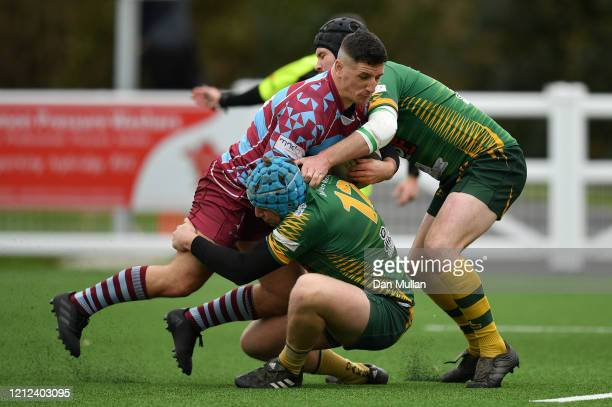 Aaron Stapleton of OPMs is tackled by Alex Broughton and Tom Richards of Plymstock Albion Oaks during the Lockie Cup Semi Final match between Old...