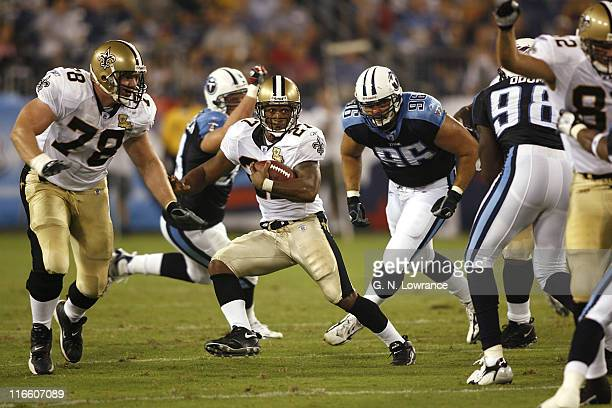 Aaron Stecker of the Saints runs for yardage during action between the New Orleans Saints and the Tennessee Titans at LP Field in Nashville,...