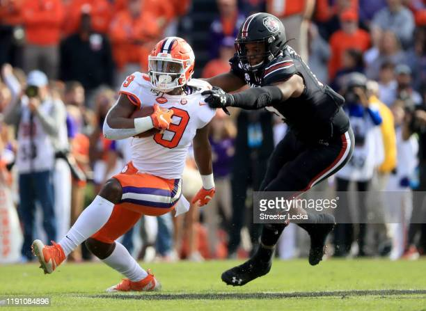 Aaron Sterling of the South Carolina Gamecocks tries to stop Travis Etienne of the Clemson Tigers during their game at Williams-Brice Stadium on...