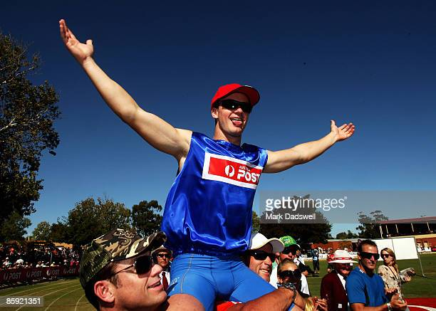 Stawell gift carnival stock photos and pictures getty images aaron stubbs of qld celebrates after winning the 2009 stawell easter gift during the 2009 stawell negle Choice Image