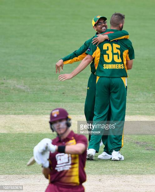 Aaron Summers and Clive Rose of the Tigers celebrate the wicket of Jack Prestwidge of the Bulls during the JLT One Day Cup match between Queensland...