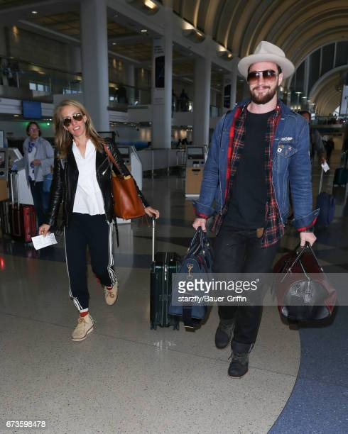 Aaron Taylor Johnson and Sam Taylor Johnson are seen at LAX on April 26 2017 in Los Angeles California