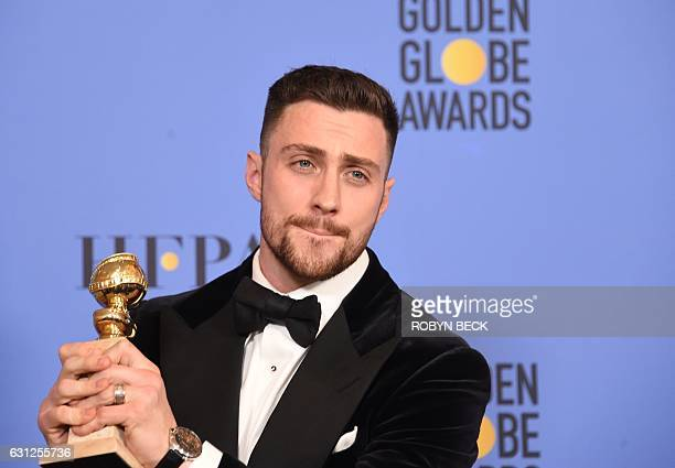 Aaron Taylor Johnson poses with the award for Best Supporting Actor his role in Noctural Animals, in the press room at the 74th annual Golden Globe...