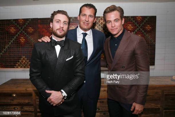 Aaron TaylorJohnson Scott Stuber and Chris Pine attend the after party for the Outlaw King TIFF 2018 opening night red carpet on September 6 2018 in...