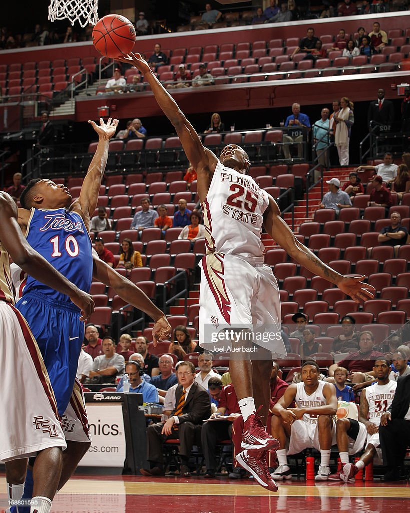 Aaron Thomas #25 of the Florida State Seminoles gets the rebound from James Woodard #10 of the Tulsa Golden Hurricane at the MetroPCS Orange Bowl Basketball Classic on December 29, 2012 at the BB&T Center in Sunrise, Florida. The Seminoles defeated the Golden Hurricane 82-63