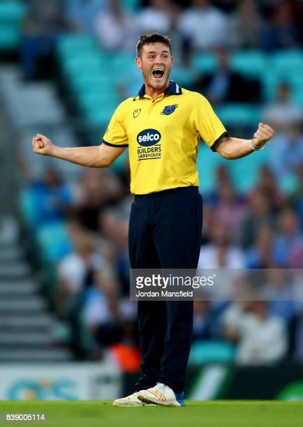 Aaron Thomason of Birmingham celebrates dismissing Aaron Finch of Surrey during the NatWest T20 Blast QuarterFinal between Surrey and Birmingham...