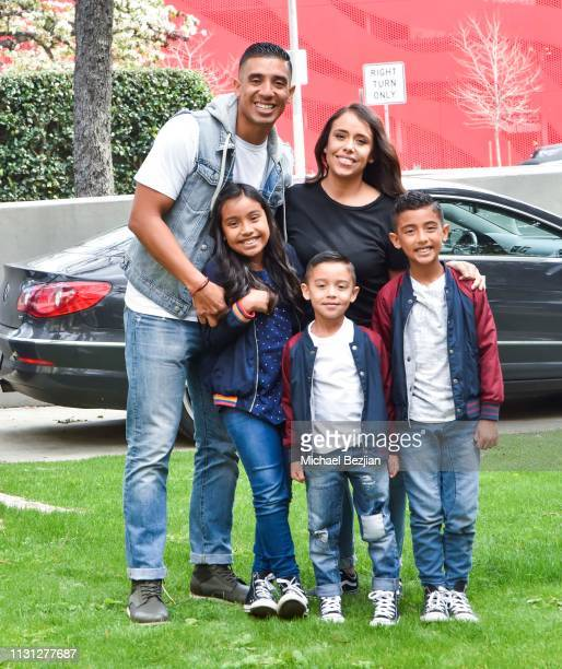 Aaron Thompson and family pose with Visual Snow Initiative at Giveback Day at TAP The Artists Project on February 21 2019 in Los Angeles California