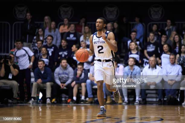 Aaron Thompson of the Butler Bulldogs brings the ball up the court in the game against the Brown Bears in the second half at Hinkle Fieldhouse on...