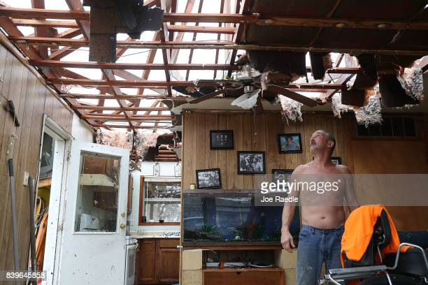 Aaron Tobias who said he lost everything stands in what is left of his home after Hurricane Harvey blew in and destroyed most of the house on August...