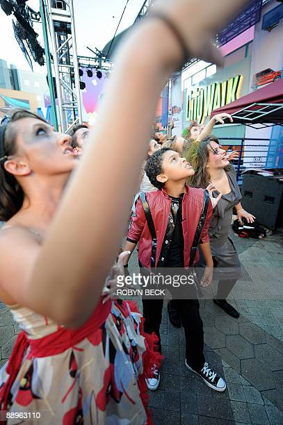 Aaron Tolias performs with the Universal Moonwalk Zombie Dancers during a tribute to Michael Jackson at Universal CityWalk in Universal City...