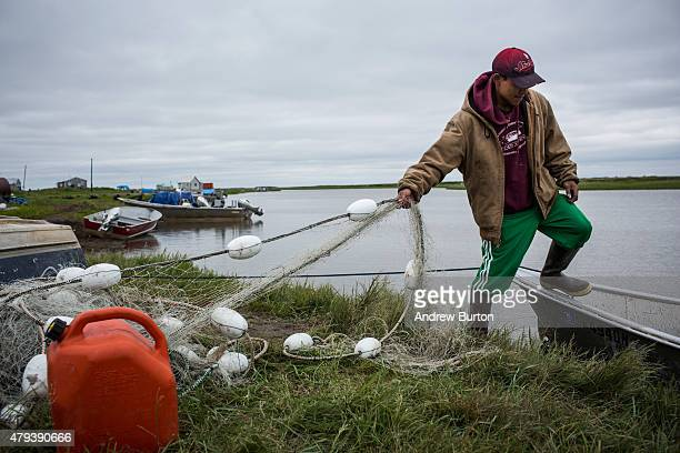 Aaron Tom prepares his boat to go fishing for salmon on July 1 2015 in Newtok Alaska Newtok has a population of approximately of 375 ethnically Yupik...