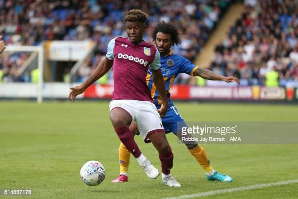 Aaron Tshibola of Aston Villa and Junior Brown of Shrewsbury Town during the preseason friendly match between Shrewsbury Town and Aston Villa at...