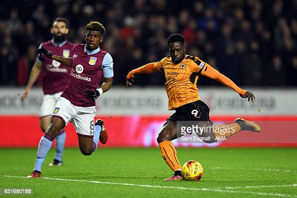 Aaron Tshibola of Aston Villa and Nouha Dicko of Wolverhampton Wanderers during the Sky Bet Championship match between Wolverhampton Wanderers and...