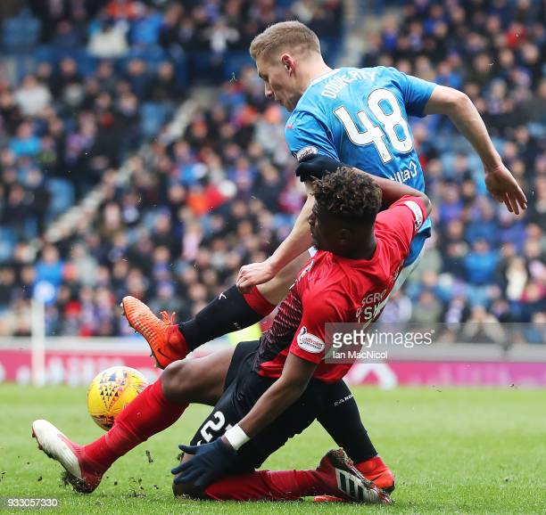 Aaron Tshibola of Kilmarnock vies with Greg Docherty of Rangers during the Ladbrokes Scottish Premiership match between Rangers and Kilmarnock at...