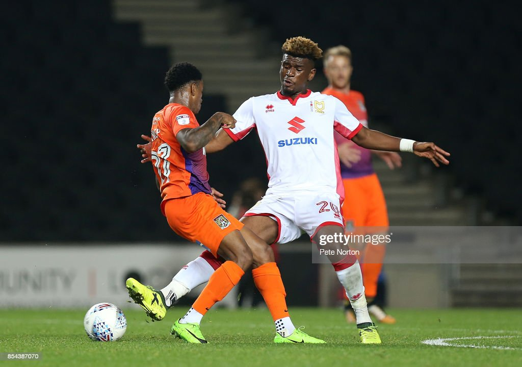 Aaron Tshibola of Milton Keynes Dons contests the ball with Raheem Hanley of Northampton Town during the Sky Bet League One match between Milton Keynes Dons and Northampton Town at StadiumMK on September 26, 2017 in Milton Keynes, England.