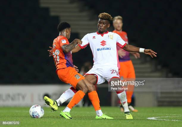 Aaron Tshibola of Milton Keynes Dons contests the ball with Raheem Hanley of Northampton Town during the Sky Bet League One match between Milton...