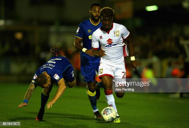 Aaron Tshibola of MK Dons takes on Barry Fuller of AFC Wimbledon during the Sky Bet League One match between AFC Wimbledon and Milton Keynes Dons at...
