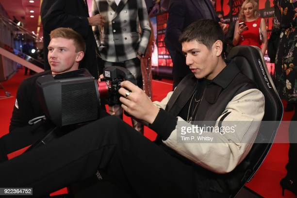 Aaron Unknown competes on the Formula E Simulators at the BRITS official aftershow party in partnership with Tempus Magazine at the Intercontinental...