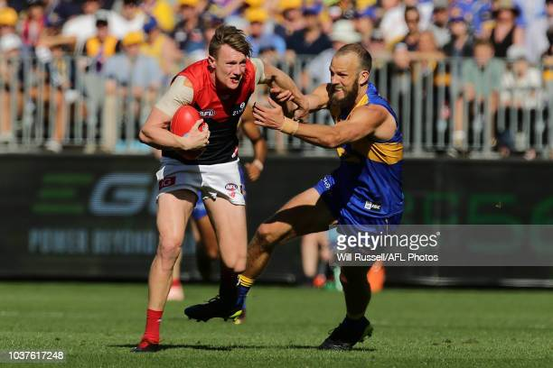 Aaron VandenBerg of the Demons fends off Will Schofield of the Eagles during the AFL Prelimary Final match between the West Coast Eagles and the...