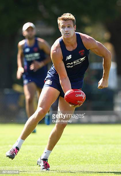 Aaron Vandenberg of the Demons handballs during a Melbourne Demons AFL preseason training session at Gosch's Paddock on December 18 2015 in Melbourne...