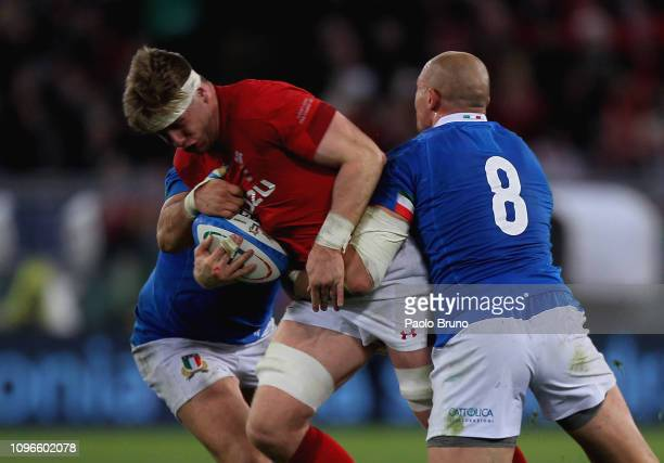 Aaron Wainwright of Wales is tackled by Simone Ferrari and Sergio Parisse Italy during the Guinness Six Nations match between Italy and Wales at...