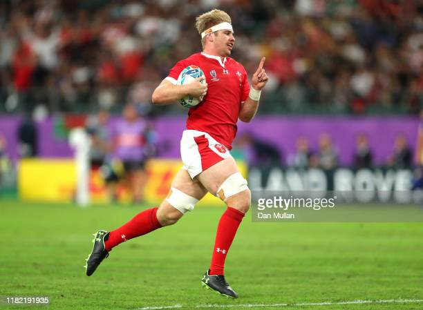 Aaron Wainwright of Wales runs with the ball on his way to scoring his team's first try during the Rugby World Cup 2019 Quarter Final match between...