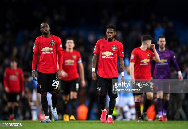 Aaron WanBissaka and Fred of Manchester United react at fulltime after the Carabao Cup Semi Final match between Manchester City and Manchester United...