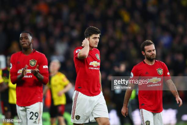 Aaron Wan-Bissaka, Harry Maguire and Juan Mata of Manchester United react after the Premier League match between Watford FC and Manchester United at...