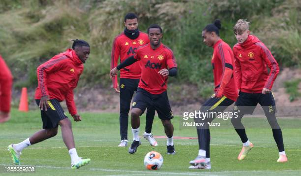 Aaron WanBissaka Mason Greenwood Ethan Laird Tahith Chong Brandon Williams of Manchester United in action during a first team training session at Aon...