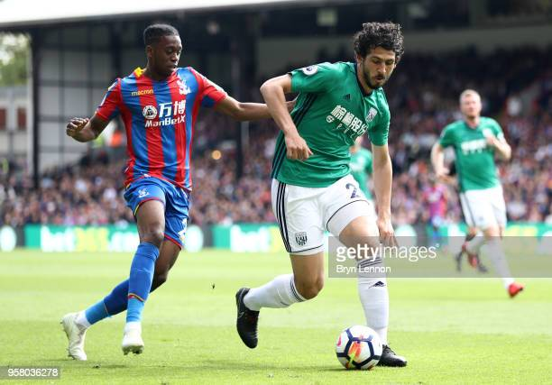 Aaron WanBissaka of Crystal Palacae nd Ahmed ElSayed Hegazi of West Bromwich Albion in action during the Premier League match between Crystal Palace...