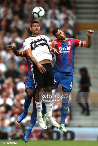 Aaron WanBissaka of Crystal Palace Aleksandar Mitrovic of Fulham and Luka Milivojevic of Crystal Palace compete for a header during the Premier...