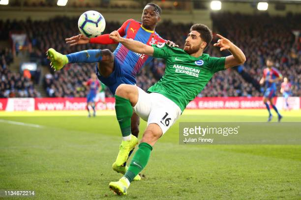 Aaron WanBissaka of Crystal Palace battles for possession with Alireza Jahanbakhsh of Brighton and Hove Albion during the Premier League match...