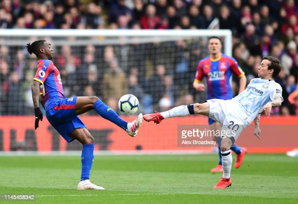 Aaron Wan-Bissaka of Crystal Palace battles with Bernard of Everton during the Premier League match between Crystal Palace and Everton FC at Selhurst...