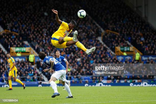 Aaron WanBissaka of Crystal Palace competes with Bernard of Everton during the Premier League match between Everton FC and Crystal Palace at Goodison...