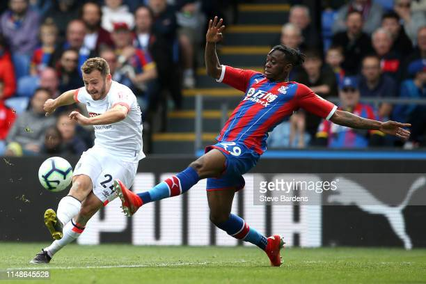 Aaron WanBissaka of Crystal Palace is challenged by Ryan Fraser of AFC Bournemouth during the Premier League match between Crystal Palace and AFC...