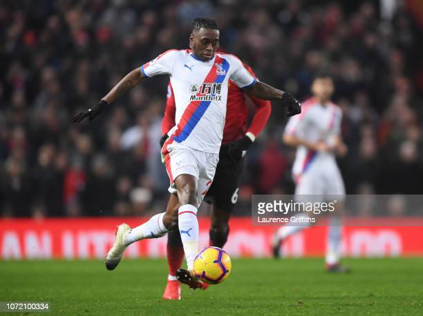 Aaron WanBissaka of Crystal Palace runs with the ball during the Premier League match between Manchester United and Crystal Palace at Old Trafford on...