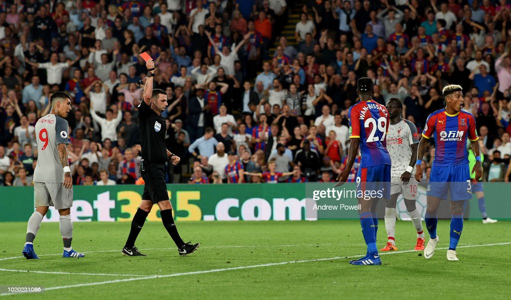 Aaron Wan-Bissaka of Crystal Palace sent off after fouling Mohamed Salah of Liverpool during the Premier League match between Crystal Palace and Liverpool FC at Selhurst Park on August 20, 2018 in London, United Kingdom.