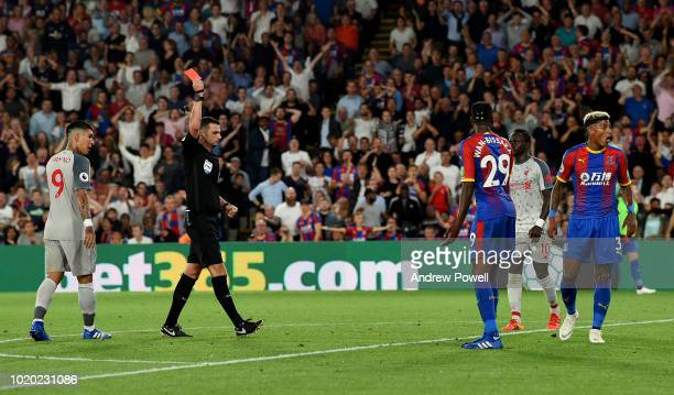 Aaron WanBissaka of Crystal Palace sent off after fouling Mohamed Salah of Liverpool during the Premier League match between Crystal Palace and...