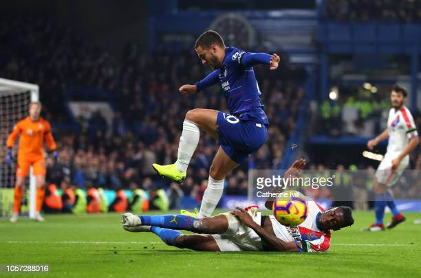 Aaron WanBissaka of Crystal Palace tackles Eden Hazard of Chelsea during the Premier League match between Chelsea FC and Crystal Palace at Stamford...