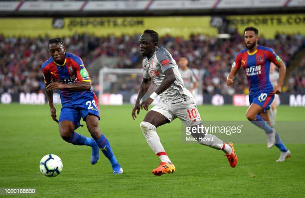 Aaron WanBissaka of Crystal Palace takes on Sadio Mane of Liverpool during the Premier League match between Crystal Palace and Liverpool FC at...