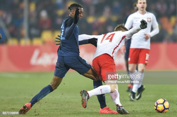 Aaron WanBissaka of England competes with Marcin Listkowski of Poland during the U20 Elite League match between Poland and England at the Municipal...