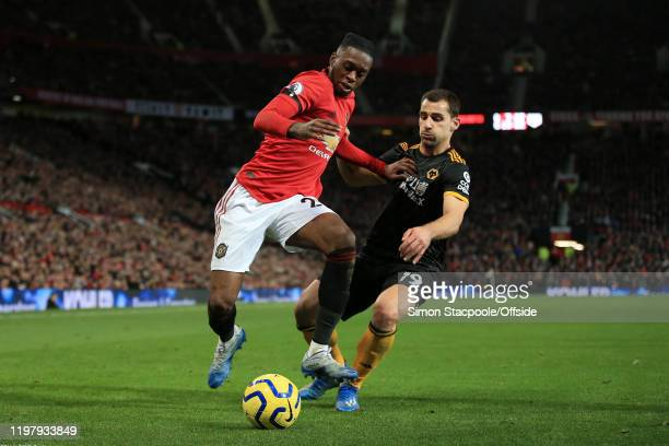 Aaron Wan-Bissaka of Man Utd battles with Jonny of Wolves during the Premier League match between Manchester United and Wolverhampton Wanderers at...