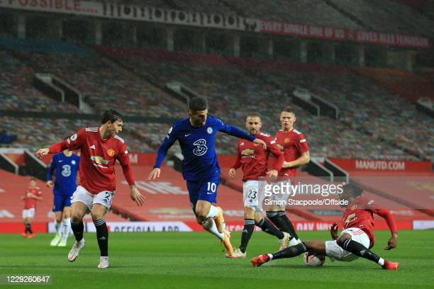 Aaron WanBissaka of Man Utd tackles Christian Pulisic of Chelsea during the Premier League match between Manchester United and Chelsea at Old...