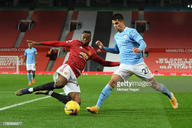 Aaron Wan-Bissaka of Manchester United and Joao Cancelo of Manchester City battle for the ball during the Premier League match between Manchester...