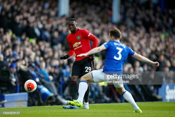 Aaron WanBissaka of Manchester United and Leighton Baines of Everton FC during the Premier League match between Everton FC and Manchester United at...